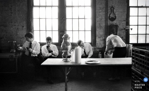Brooklyn wedding photographer shoots a black and white image of the groomsmen getting ready for the ceremony
