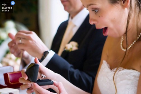 Milan wedding photographer captured this image of the surprised look on the brides face as she opens a present at her reception