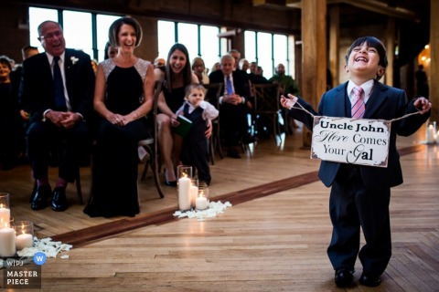 Chicago wedding photographer captured this adorable photo of the grooms nephew preparing him for the arrival of his bride