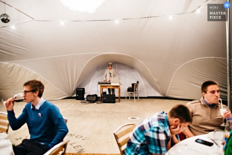 Ljubljana wedding photographer captured this photo of the DJ and an empty dance floor at this tented reception