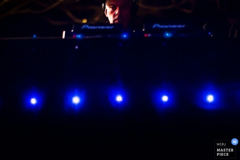 San Francisco wedding photographer captured this image of a DJ booth strung with blue lights