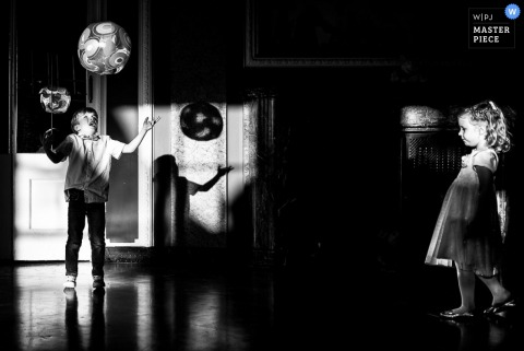 Baden-Wurttemberg wedding photographer captured this photo of two children playing with a balloon at the reception