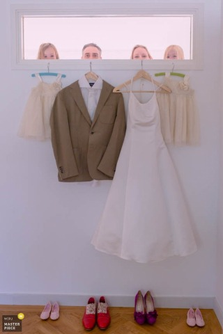Zuid Holland bride and groom stand behind their tux and dress - Netherlands wedding photo