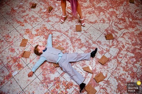 Key West boy makes angels on the ground at the wedding - Florida wedding photojournalism