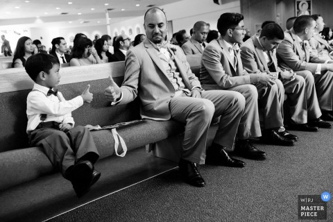 San Fransisco Best man and boy give thumbs up in the front row of pews at the church wedding - California wedding photo