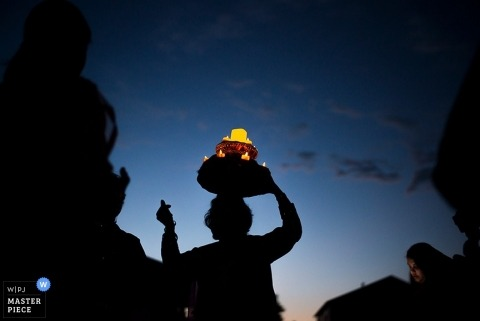 Boulder wedding photographer captured the silhouette of a man releasing a lantern into the darkening sky