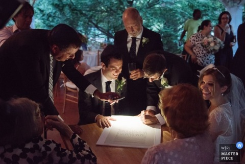 Manhattan bridal party at the reception ketubah signing - New York wedding photo