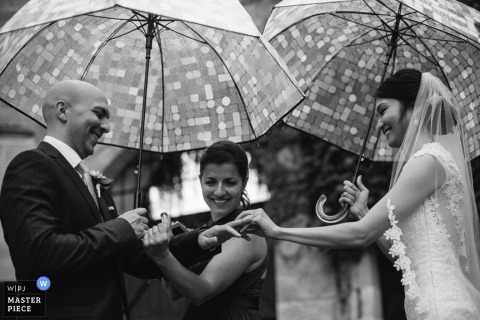 Nouvelle Aquitaine bride and groom hold umbrellas during the ceremony - France wedding photography