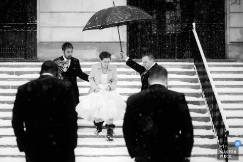 Boston groomsmen holds an umbrella for the bride after the wedding - Massachusetts wedding photo