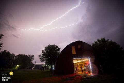 Chicago wedding reception inside during lightning storm - Illinois wedding photo