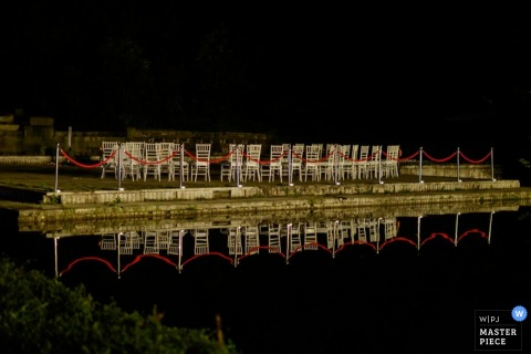 Sofia outdoor night reception tables next to water before the guests arrive - Bulgaria wedding photojournalism