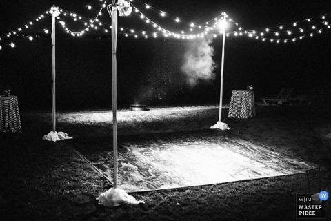 Brooklyn dance floor under the lights at the outdoor reception - New York wedding photojournalism