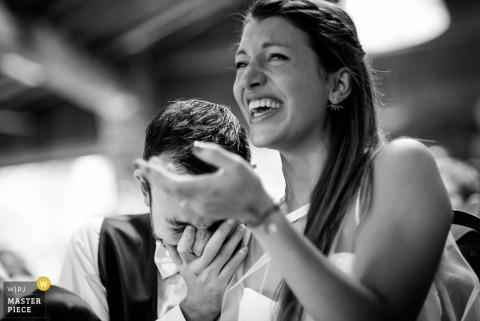 Nantes bride and groom laugh at the reception - Loire Atlantique wedding photography
