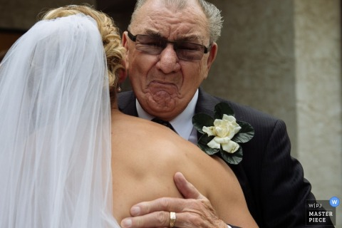 Alberta bride hugs father at the wedding ceremony -  Canada wedding photo