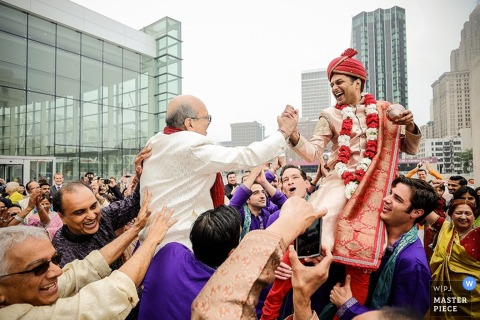 Detroit groom and father celebrate in the streets with guests - Michigan wedding photo