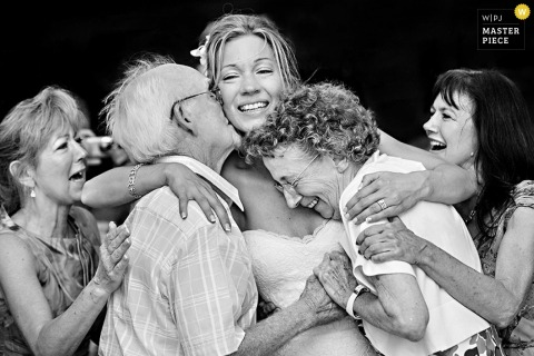 Key West bride hugs mother and father at the wedding - Florida wedding photojournalism
