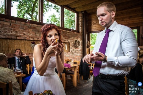 Prague bride and groom eating cake at the reception - Czech Republic wedding photo