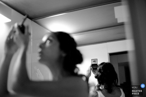 Rome bride looking at her eye make up before the wedding - Lazio wedding photography