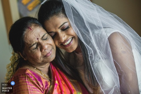 Tamil Nadu wedding photographer captured this photo of the bride and her mother hugging affectionately