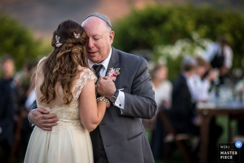 A man and his daughter embrace during her wedding day. Image by a Los Angeles, California wedding photographer.