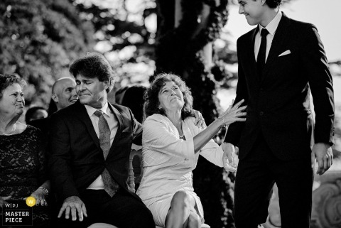 Charleston parents with the groom during the ceremony - South Carolina wedding photojournalism