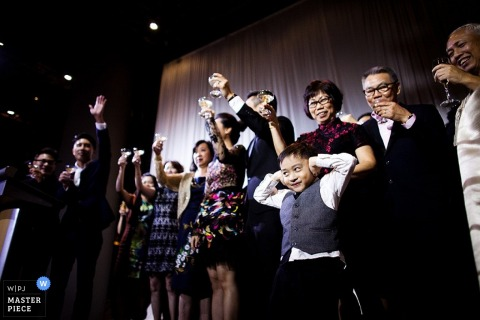 Singapore bride and groom make a toast at the reception | Asia wedding photo