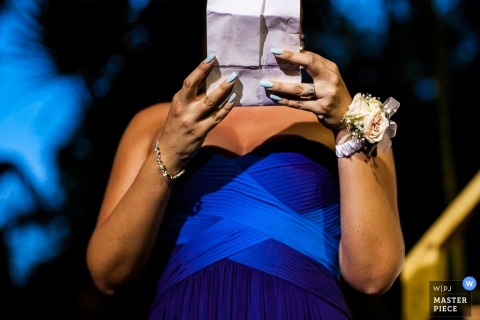 Bahamas bridesmaid reading her speech at the reception | Central America wedding photojournalism
