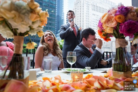 Chicago bride and groom laugh as best man does his speech at the reception | Illinois wedding photography