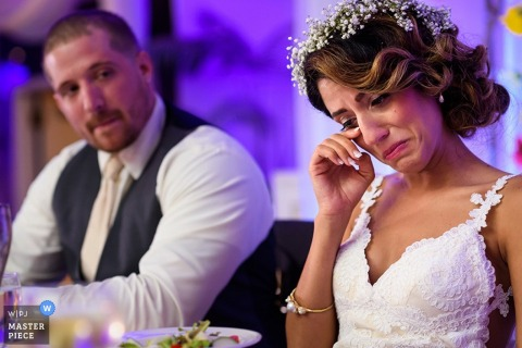 Arezzo bride and groom listen to emotional reception speeches | Tuscany wedding photo
