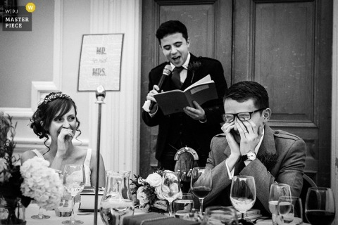 Scotland wedding reception photo of groom being embarassed by speech