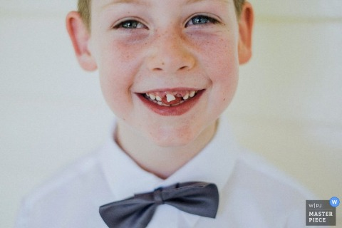 New South Wales boy smiles at the camera at the wedding | Australia wedding portrait of boy