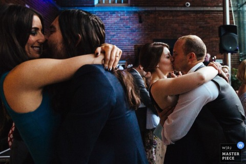 London guests kiss on the dance floor at the reception | England wedding photojournalism