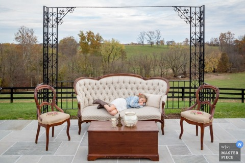 Little girl in Washington DC gets tired on the couch at the wedding | District of Columbia photo