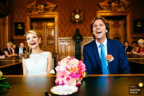 wedding photography in Ljubljana | bride and groom laughing during the ceremony