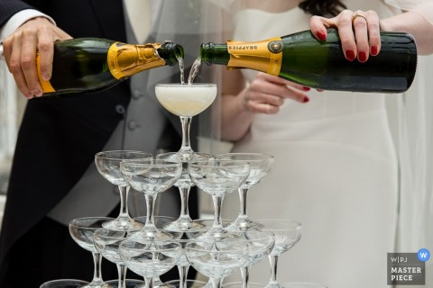 Wedding reception photography of couple pouring champaign | Dublin weddings