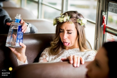 Pennsylvania wedding photograph of bride's face after taking a drink on a bus | Wedding day moments captured in Philadelphia