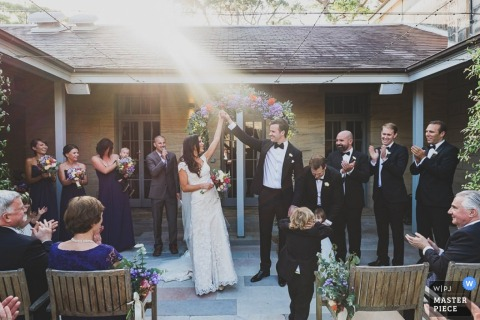 New South Wales guests clap after the bride and groom just got married  | Australia wedding photo