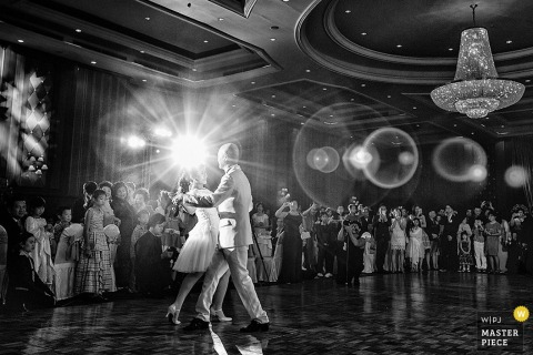 Bangkok guests watch and smile as bride and groom dance at the reception   Thailand wedding photo