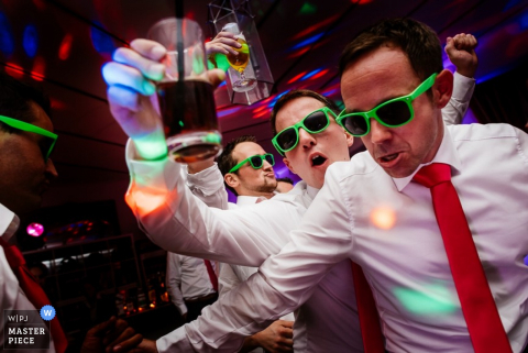 Baden Wurttemberg groom and groomsmen enjoying drinks at dancing at the reception | Germany wedding photojournalism