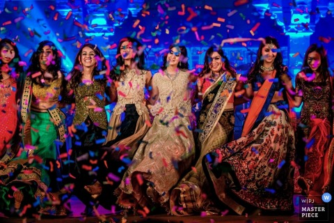 Toronto bride and bridesmaids dance with confetti falling around them | Ontario wedding photojournalism
