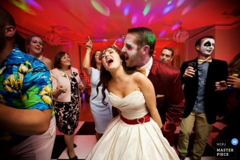 Jersey bride and groom dancing at the reception with face paint | Channel Islands wedding photojournalist