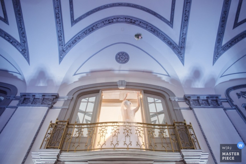 Cleveland bride throws the bouquet from a balcony | Ohio wedding photography