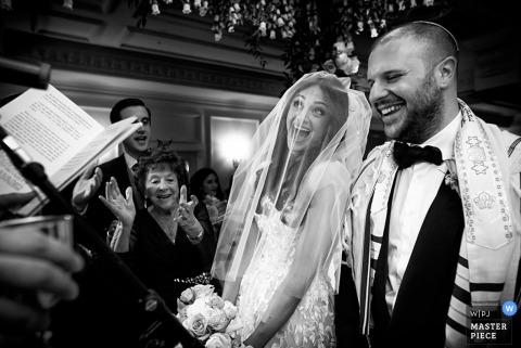 Devon bride and groom laugh during the wedding ceremony   England wedding photo