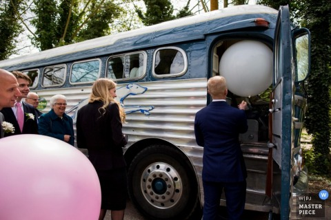 Noord Holland bridal party getting into a bus | Netherlands weddings
