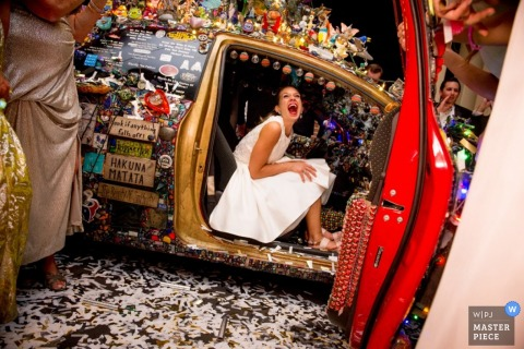 Houston wedding photograph of bride in an Art Car | capturing Texas wedding moments