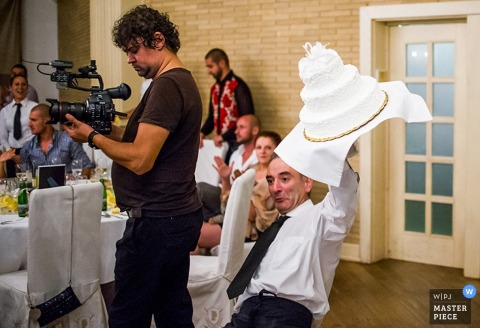 Sofia man losing the wedding cake at the reception | Bulgaria wedding photojournalism