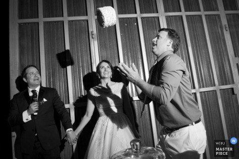 Austin groom throws the cake top into the air at the reception | Texas wedding photo