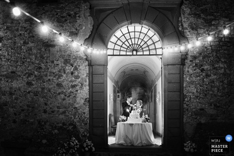 Arezzo bride and groom feed each other cake