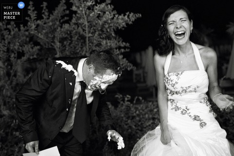 Bride laughs after the groom gets cake in his face in Arezzo | Tuscany wedding photography