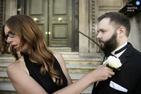 London groom getting help with his tux before the wedding | England wedding reportage photo